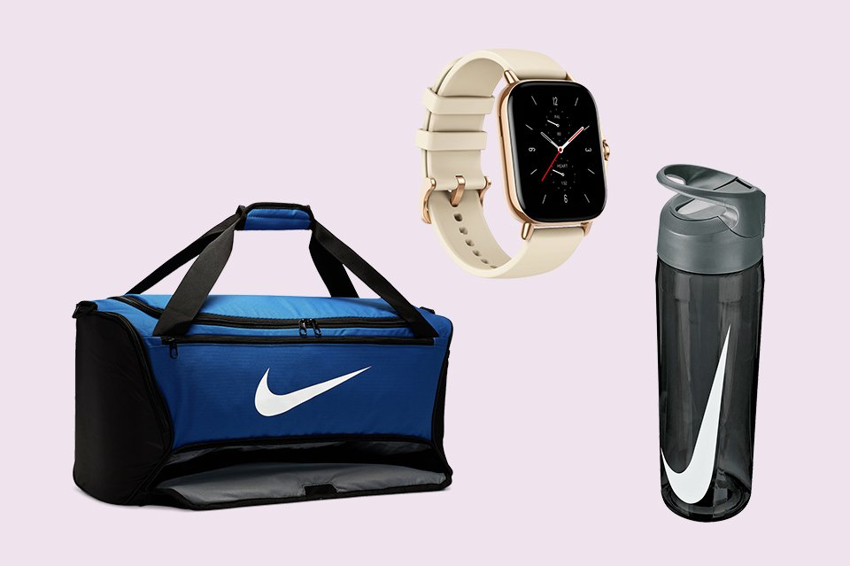 Fitness watch, water bottle and a sports holdall bag.