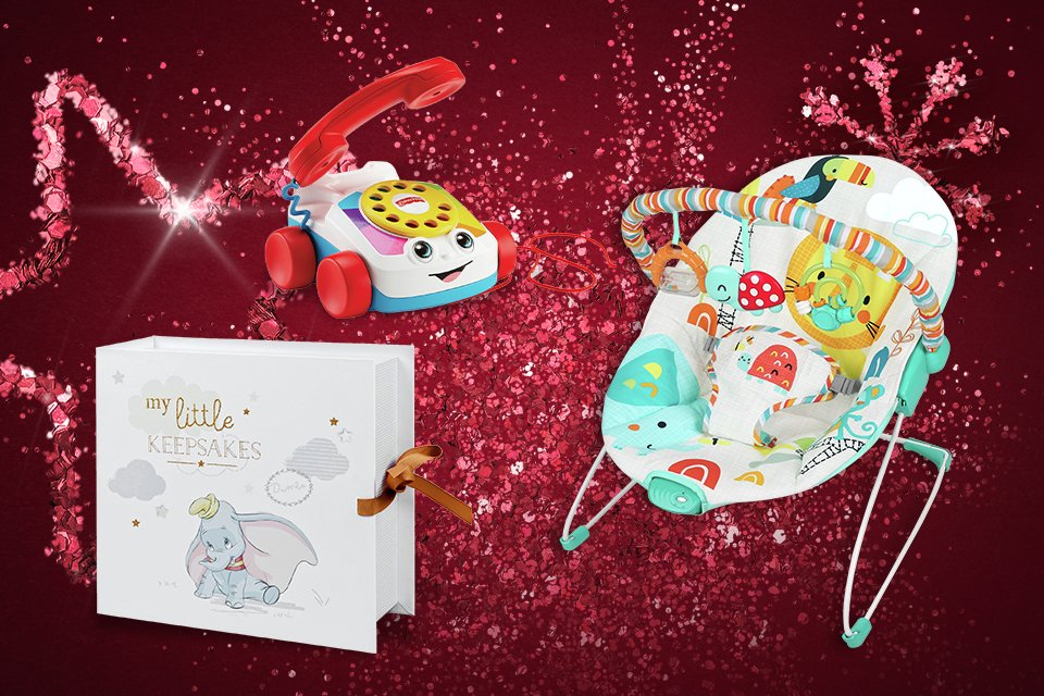 A selecton of baby gifts, including a keepsake box and a toy telephone.