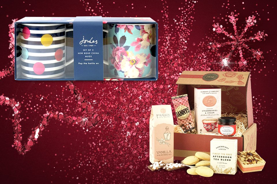 An afternoon tea hamper and a set of Joules mugs.