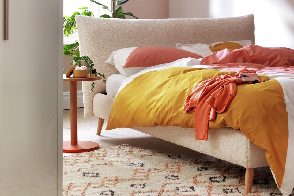 A Habitat double bed with bedside table in a bright bedroom.