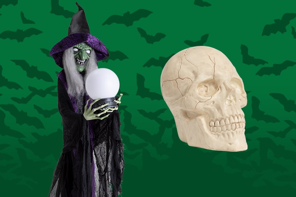 A witch clutching a crystal ball alongside a skull.