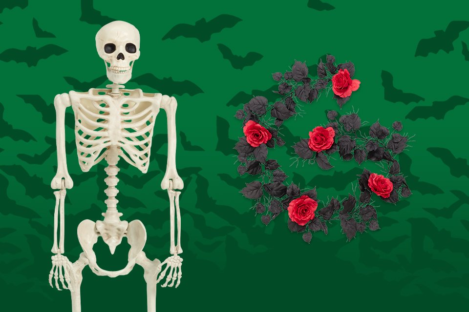 A skeleton alongside a black and rose flower garland.