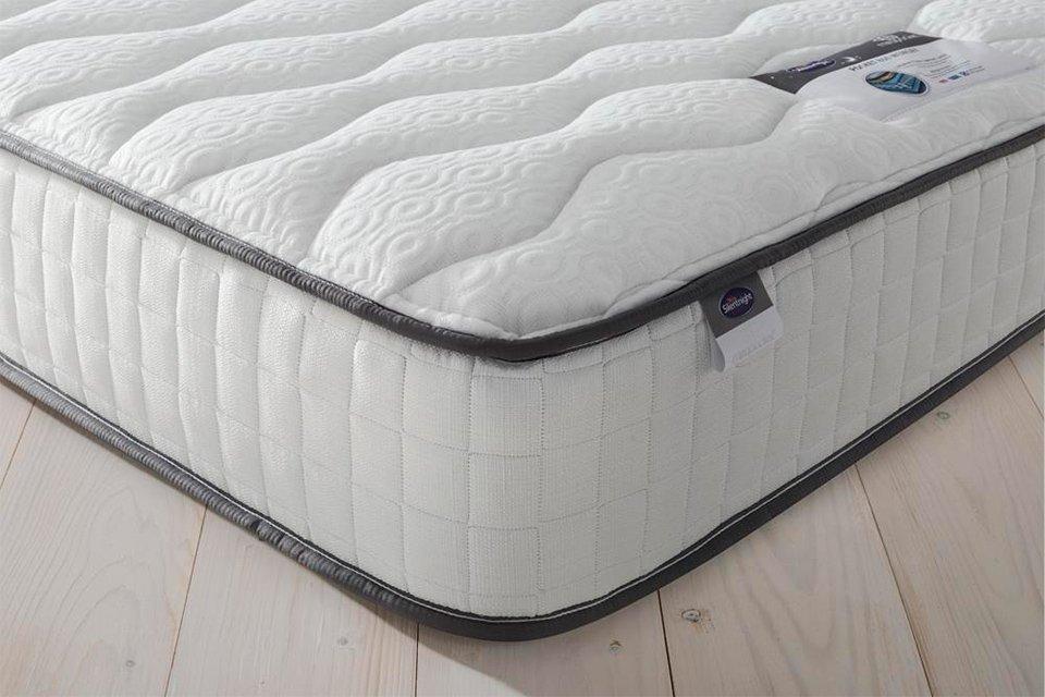 A Silentnight mattress sitting on a wooden floor.