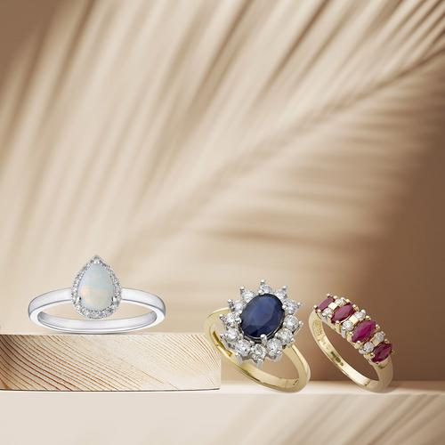 three gemstone rings displayed