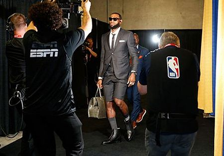 LeBron James walking into the Oracle Area wearing shorts