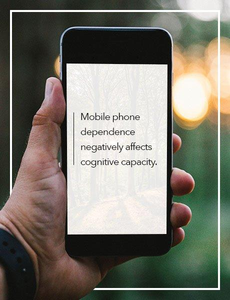 Mobile Phone in the Outdoors with a Quote Saying