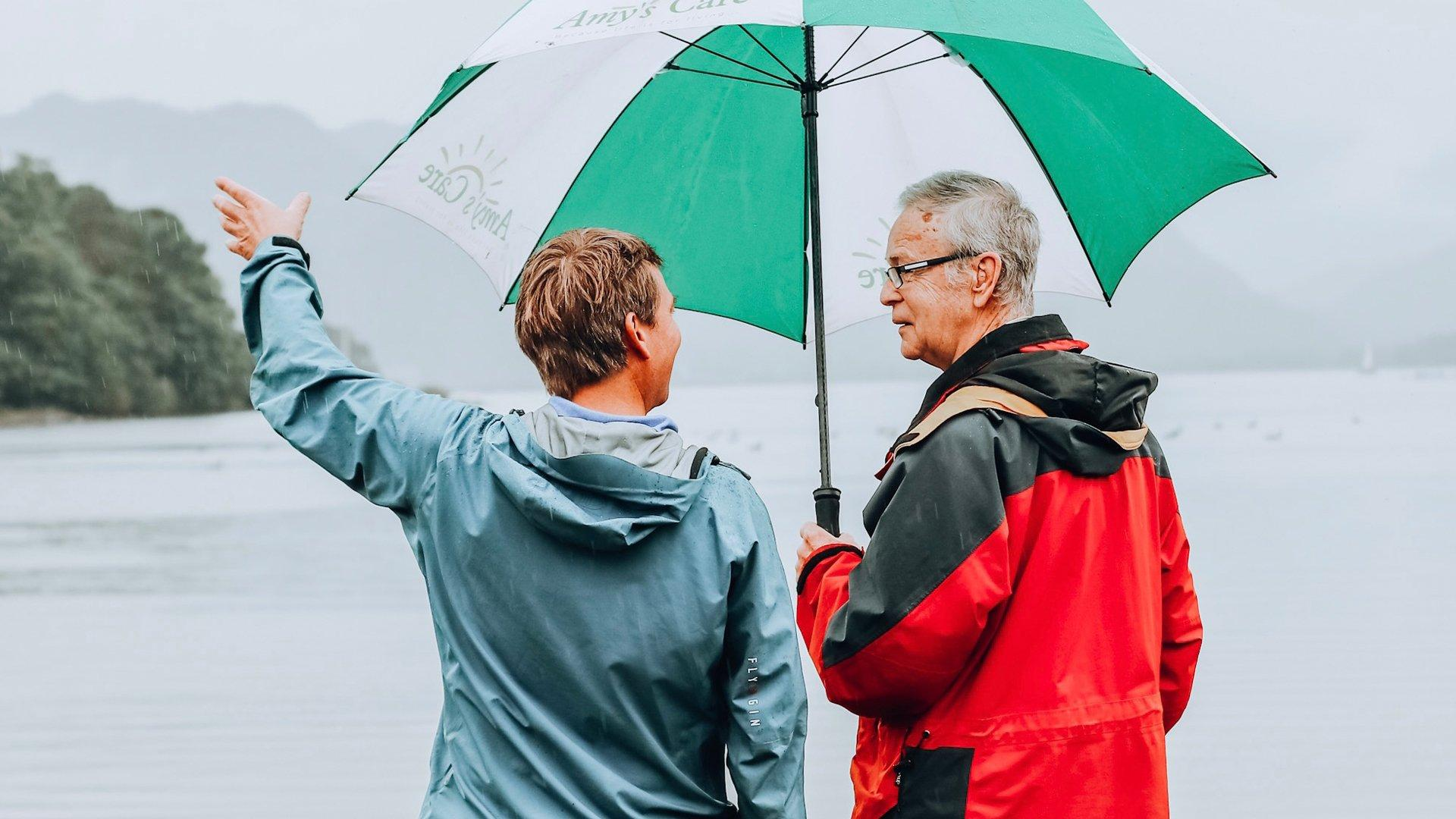 Elderly man and middle aged man enjoying an outdoor adventure in the uk