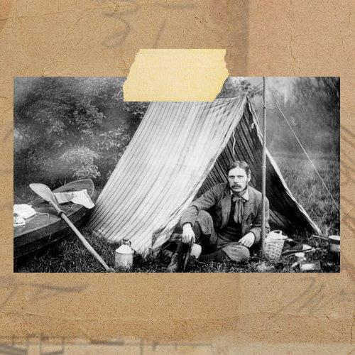 An image of Thomas Hiram Holding sat outside a tent outdoors.