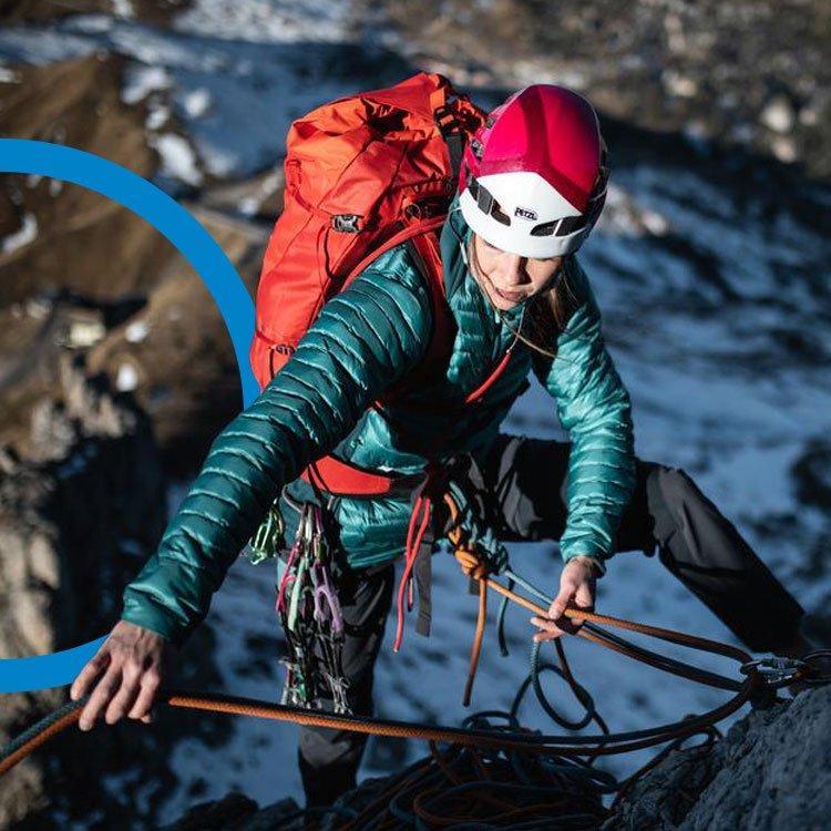 An image of a woman climbing outdoors on a rockface.