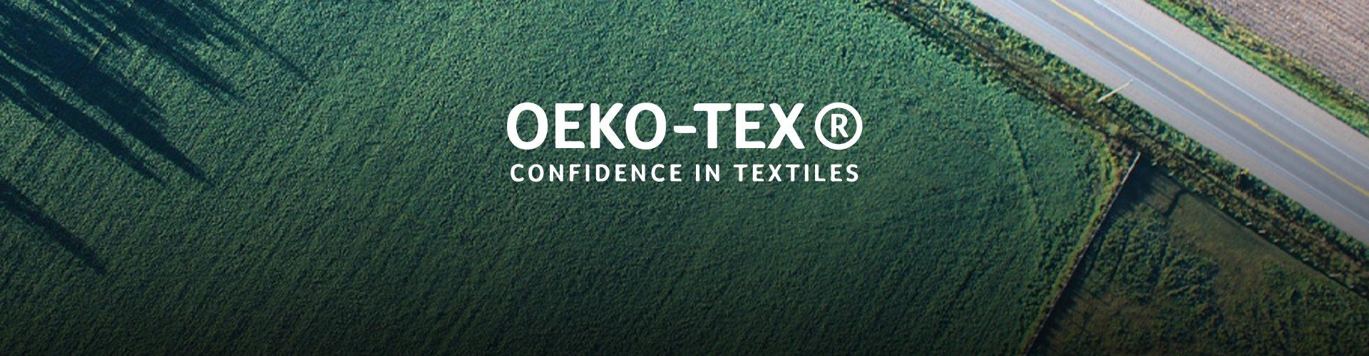 An aerial image of fields with a road running through them with text saying OEKO-TEX