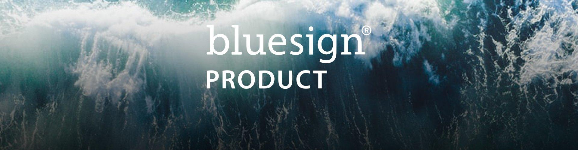 An aerial image of an ocean with a wave breaking with text saying bluesign product.