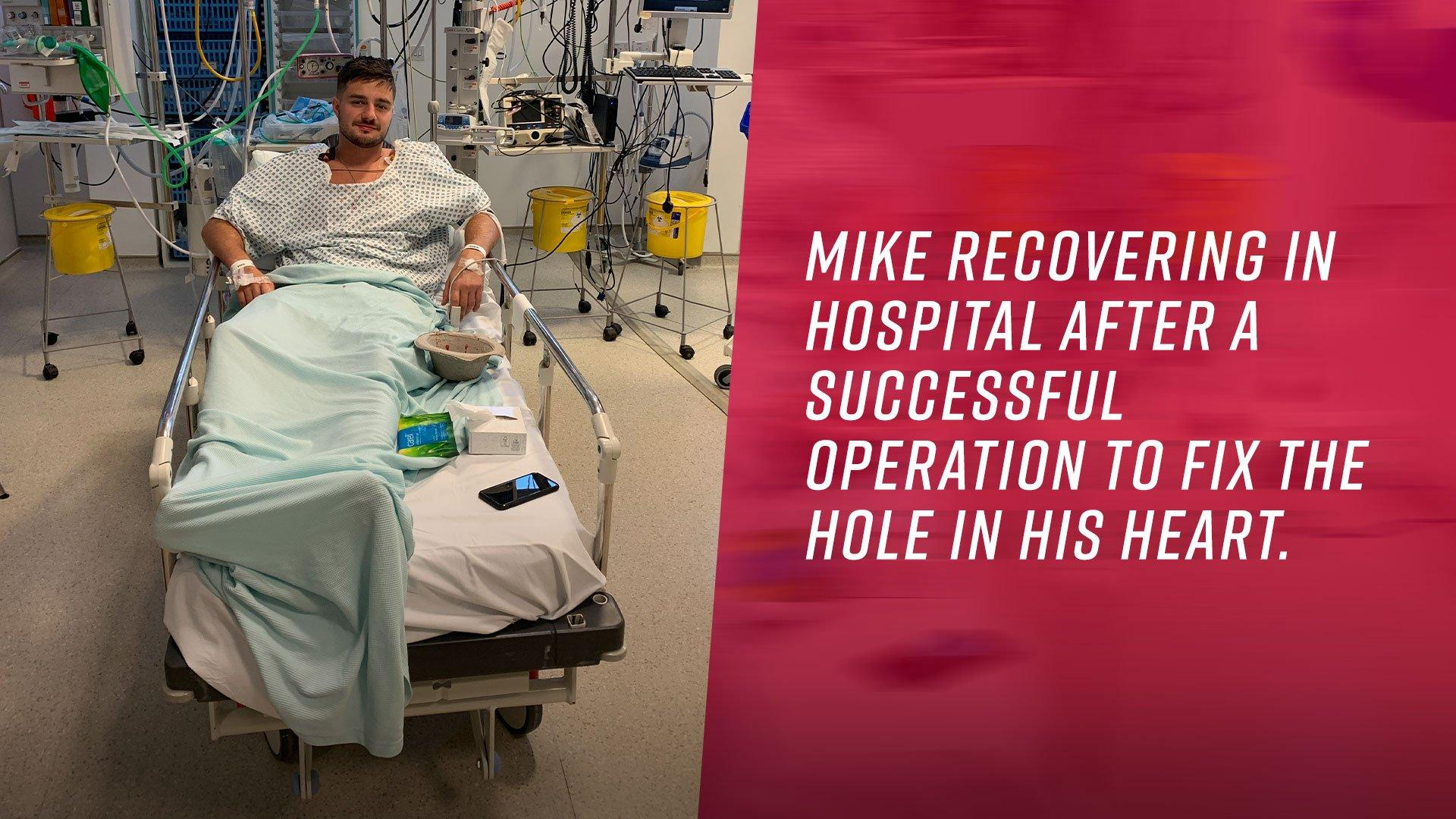 Mike recovering in hospital after a successful operation to fix the hole in his heart.