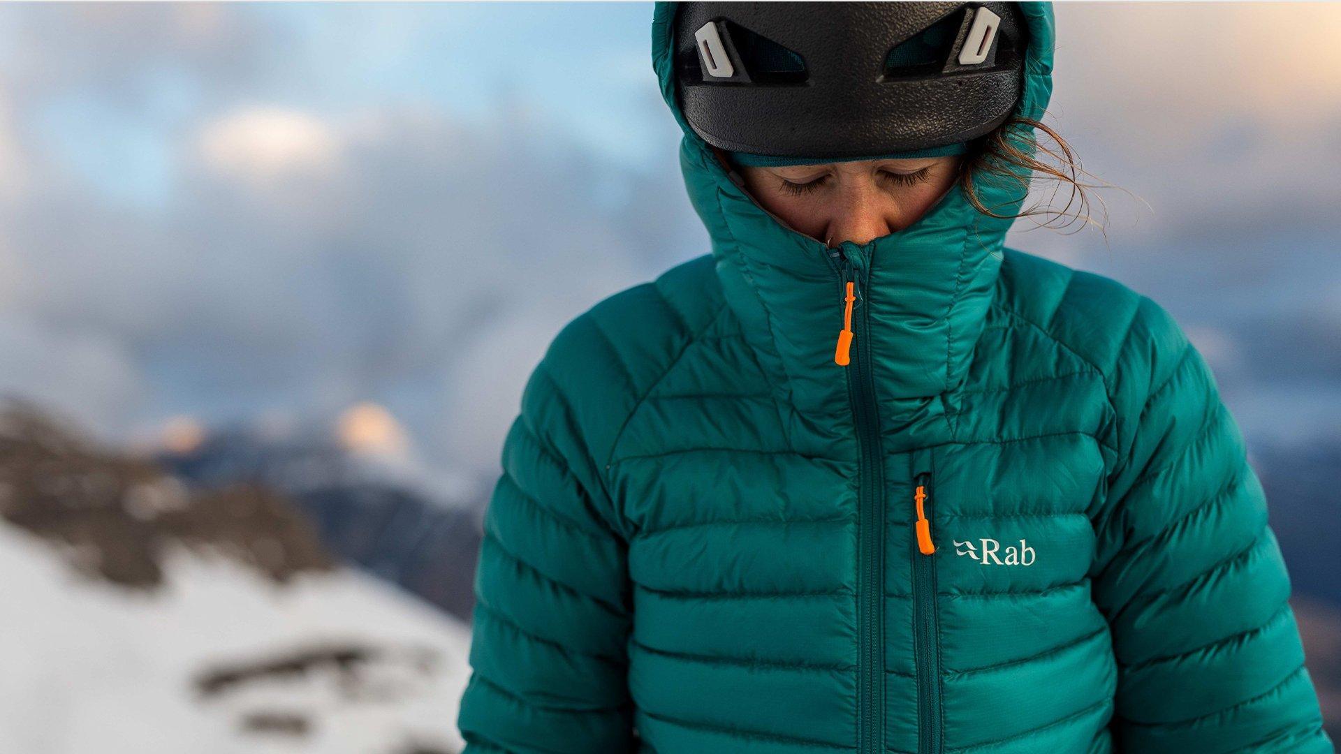 female climber wearing Rab's Microlight jacket