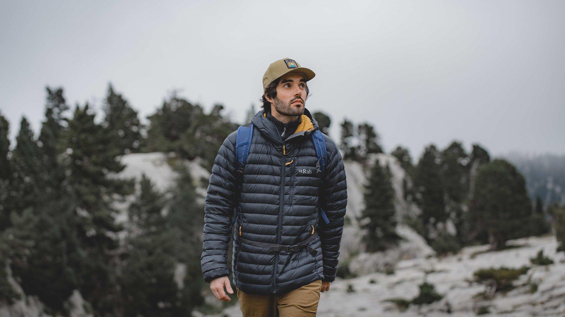 outdoor adventurer wearing Rab's Microlight jacket