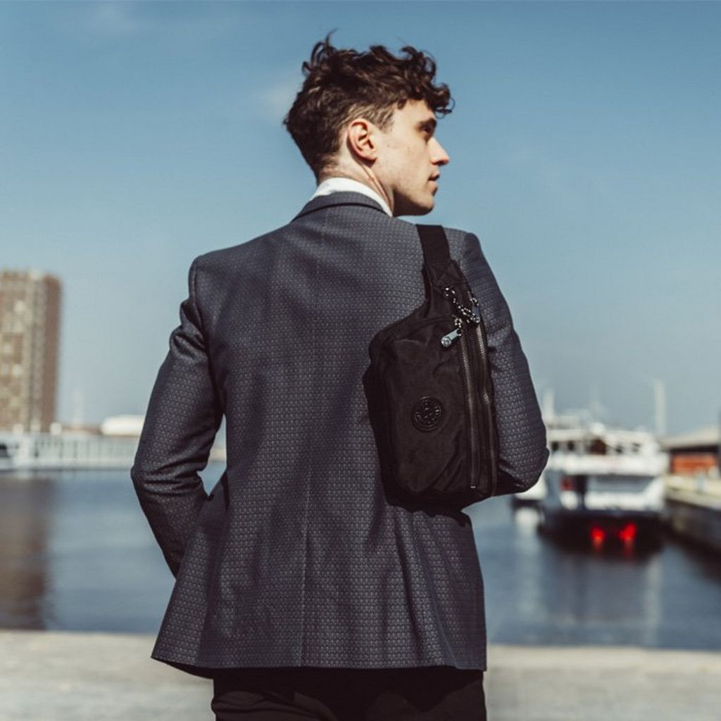 How to wear a messenger bag with a suit.