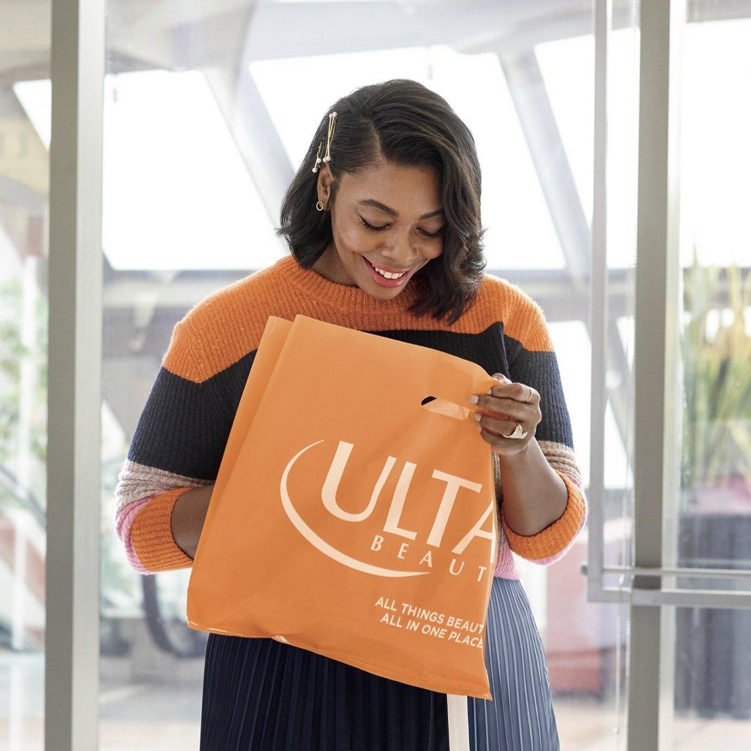 A woman picking up her buy online, pick up in store order.