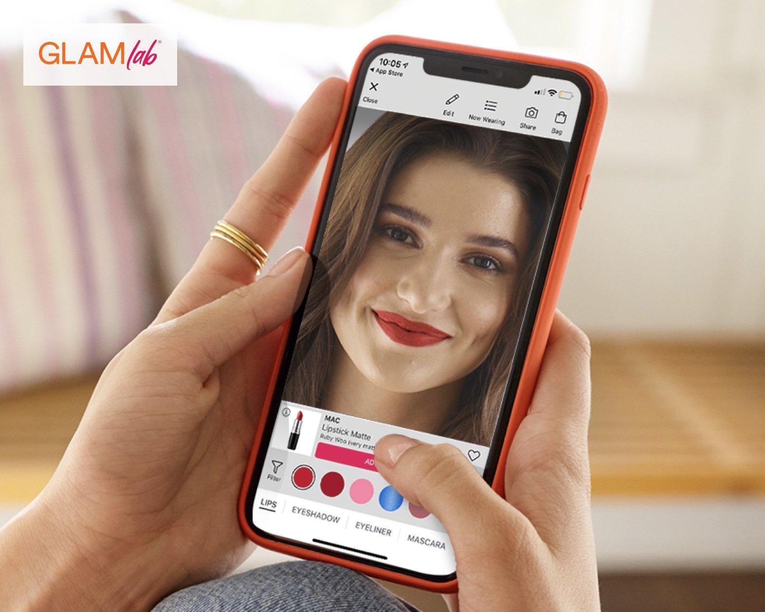 Woman on her phone using GLAMlab.