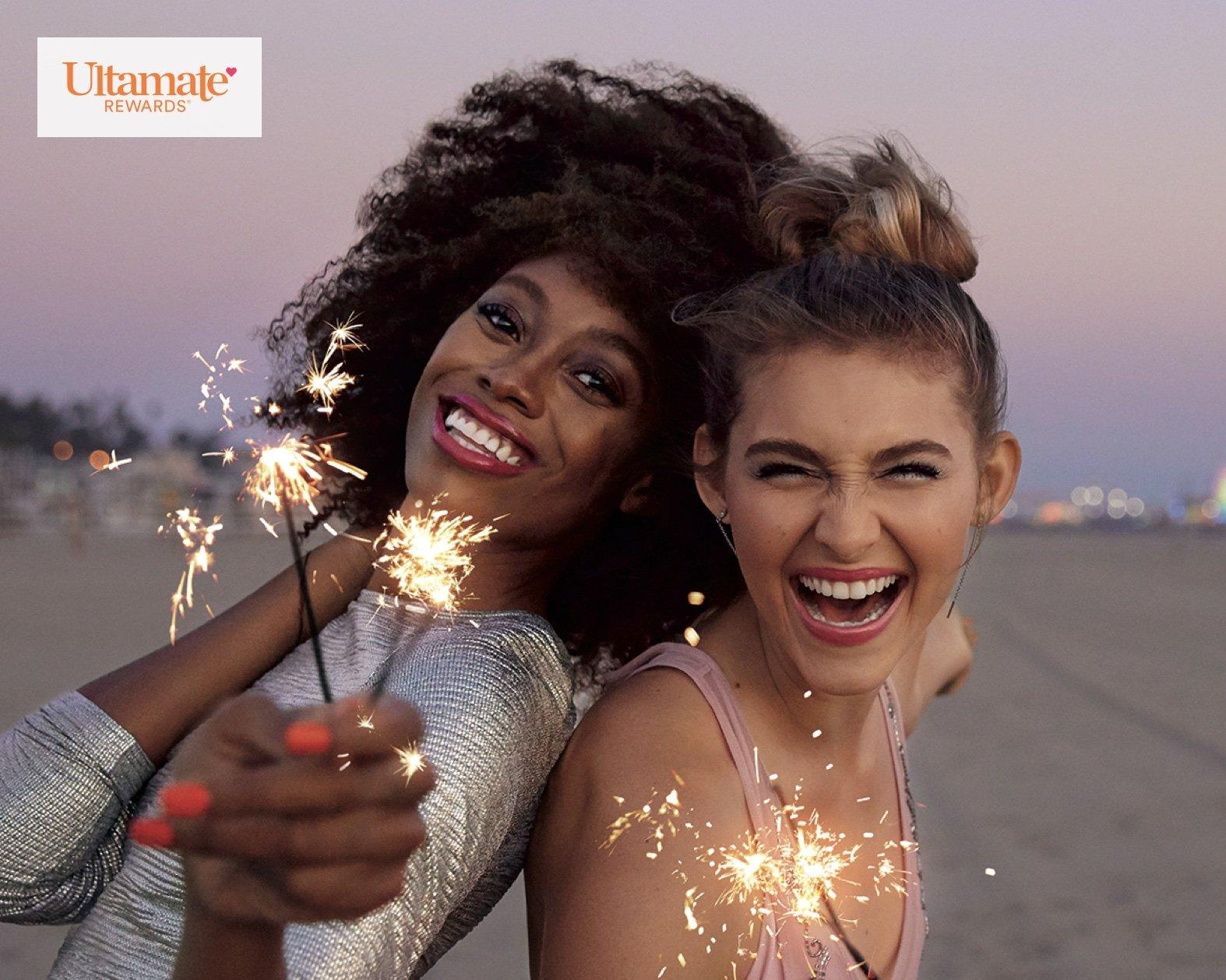 Two women celebrating on the beach.